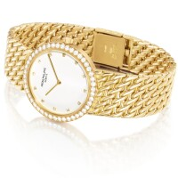44. patek philippe | calatrava, reference 5006 a yellow gold and diamond-set bracelet watch,made in 1992