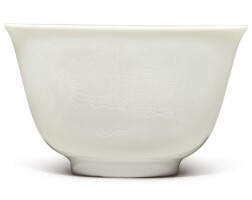 108. a fine white-glazed anhua-decorated 'dragon' cup kangxi mark and period |