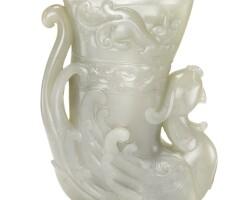 111. a greyish celadon jade 'phoenix' rhyton qing dynasty, 18th century