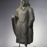 903. a grey schist figure of a standing buddha ancient region of gandhara, kushan period, 2nd/3rd century  