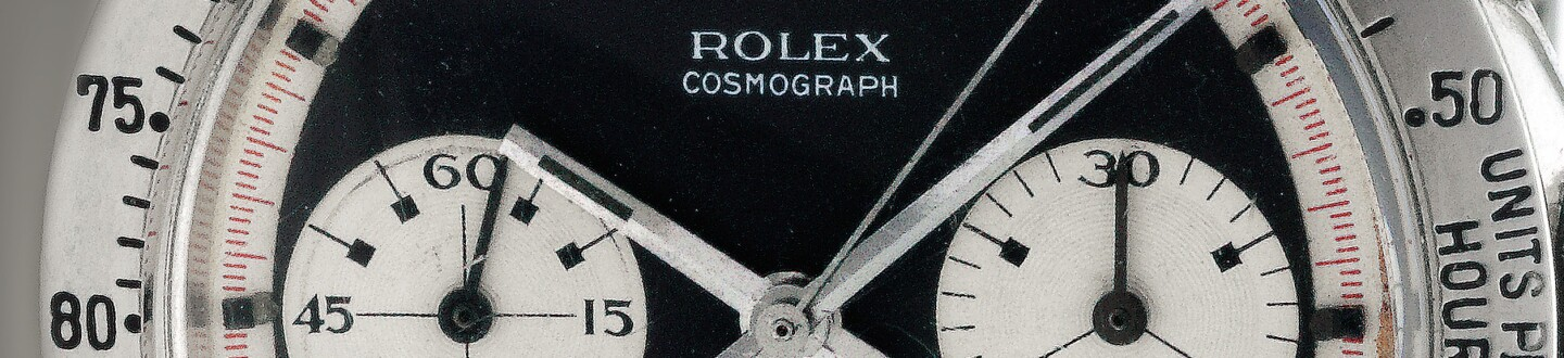 detail of a rolex daytona cosmograph dial on a watch in an auction selling vintage rolex watches