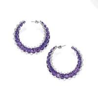 9. pair of 18 karat white gold, purple sapphire and diamond earrings