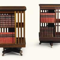 15. twoedwardian revolving crossbanded mahoganybook tables, circa 1905