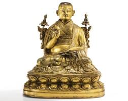 14. 十六至十七世紀 西藏 鎏金銅合金上師坐像