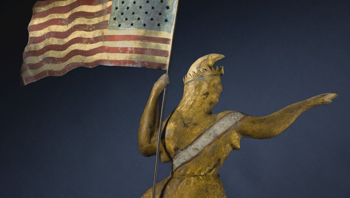 Figure of a woman holding an American flag.