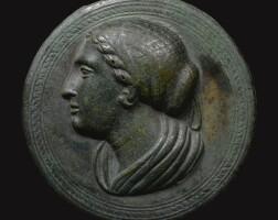 5. a greek bronze mirror, circa late 4th century b.c.