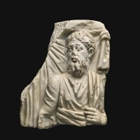 53. a roman marble sarcophagus relief fragment of a philosopher, late 3rd century a.d. | a roman marble sarcophagus relief fragment of a philosopher