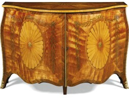 734. a george iii style satinwood and marquetry serpentine commode, in the style of john cobb