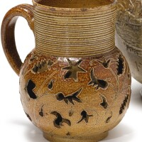 602. a nottingham or crich 'carved' brown salt-glazed stoneware jug circa 1700-05 |