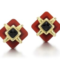 207. pair of carnelian and onyx ear clips, aldo cipullo for cartier, 1973