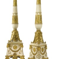 13. a pair of large empire parcel-gilt, white-painted and carved torchères, after a design by charles percier and pierre fontaine circa 1805