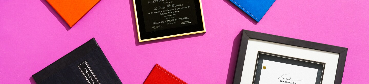 A vignette of scripts owned by Robin Williams as well as the award for his Walk of Fame star.