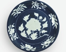 6. an exceptionally rare andlarge fine blue and white reserve-decorated 'peony' dish xuande mark and period
