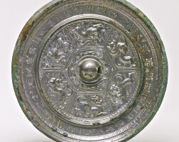 113. a bronze 'mythical beasts' mirror with inscription sui dynasty
