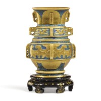 3640. an extremely rare gilt-decorated trompe l'oeil bronze-imitation archaistic vase and lacquer-imitation stand, zun seal mark and period of qianlong