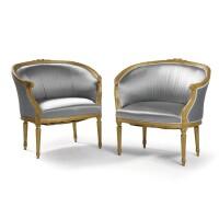 66. a pair of gilt painted bergères en corbeille in louis xvi style