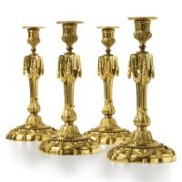 56. a set of four gilt-bronze candlesticks louis xvi, late 18th century