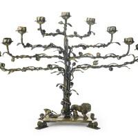146. a silver-gilt hanukah menorah, early 20th century