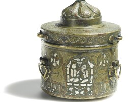 106. a khurasan silver and copper-inlaid cast brass inkwell with figures, signed byhajib mas'ud ibnahmad al-naqqash, persia, 12th century