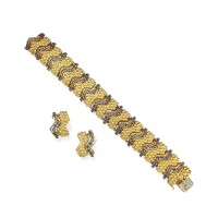 5. pair of gold and sapphire earclips and bracelet