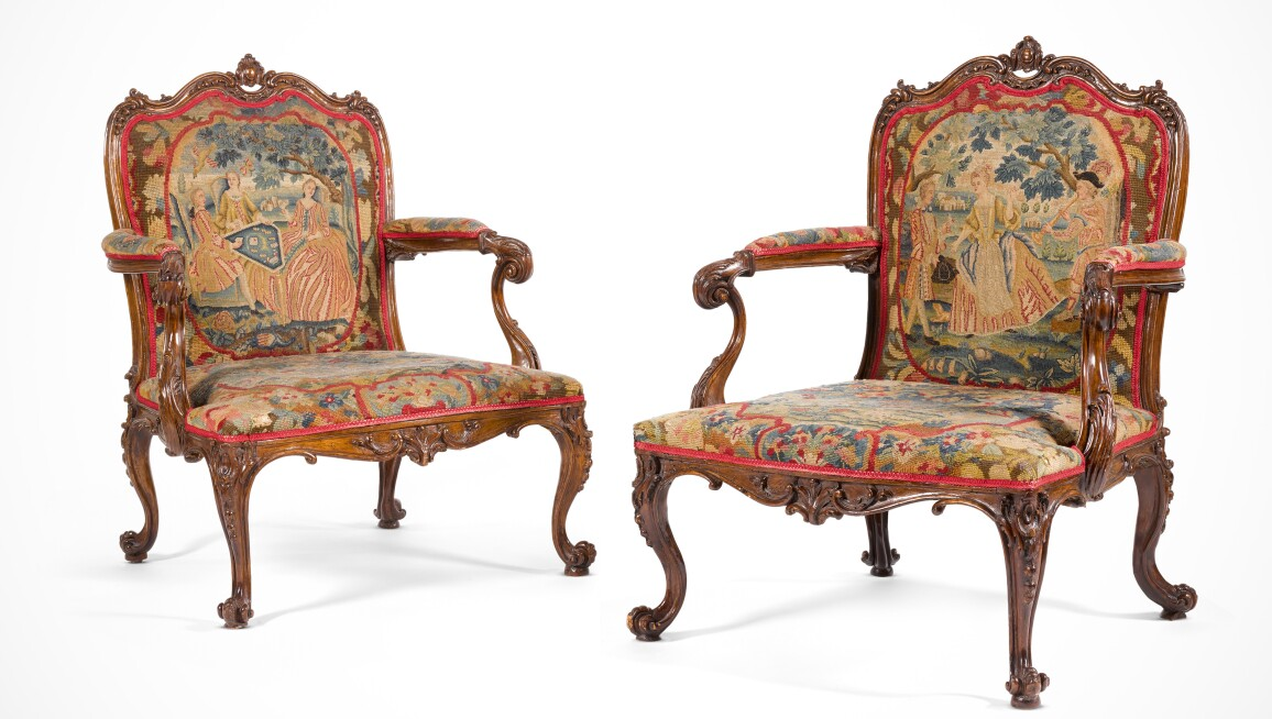 A pair of George III carved fruitwood library armchairs, circa 1760, in the manner of Thomas Chippendale