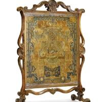 39. a régence carved walnut fire screen circa 1715