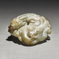 224. a white and russet jade 'coiled dragon' carving yuan - ming dynasty  