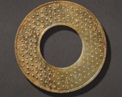 301. a celadon and russet jade disc, huan western han dynasty