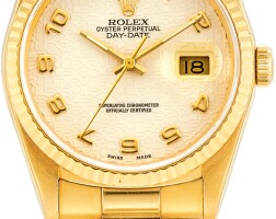 125. rolex | day-date, reference 18238 a yellow gold wristwatch with day, date and bracelet, circa 1980