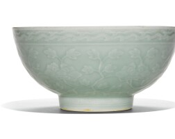 10. a large moulded and incised 'peony' bowl qianlong seal mark and period