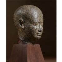 16. a red granite head of a man , 30th dynasty, 380-342 b.c.