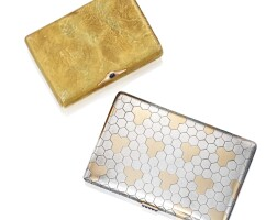 37. silver, parcel gilt and sapphire cigarette case, cartier, and gold and sapphire cigarette case