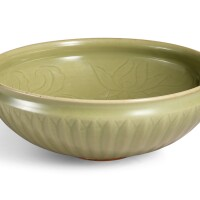 3614. a large longquan celadon and biscuit 'floral' bowl yuan dynasty |