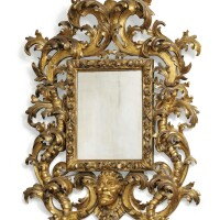 16. an italiancarved giltwood mirror, in the manner of filippo passarini (1638-1698), roma, early 18th century |