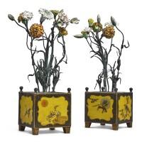 123. a pair of louis xvi lacquered tôle cache-pots mounted with tôle peinte and vincennes porcelain flowers circa 1770