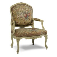 46. a fine green painted carved fauteuil à la reine, stamped i*b*mevnier, louis xv, mid 18th century