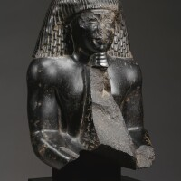6. an egyptian diorite figure of a priest of the temple of mut, late 25th/early 26th dynasty, circa 670-610 b.c.