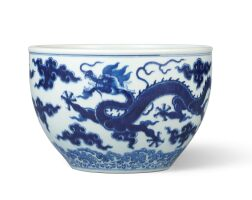 3612. a fine blue and white 'dragon' jardinière seal mark and period of qianlong |