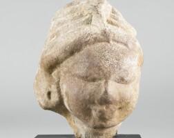 1305. a sandstone head of a deity india, post-gupta period, circa 8th century