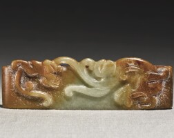 215. a celadon and russet jade 'chilong' scabbard slide qing dynasty, 19th century  