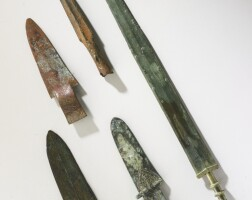 56. a group of archaic bronze weapons shang dynastyand eastern zhou period