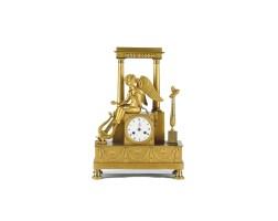3. an attractive french empire ormolu sculptural mantel clock, circa 1800
