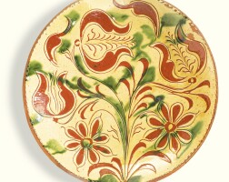 503. rare sgraffito glazed red earthenware plate with open tulips, attributed to conrad mumbouer (1761-1845) 1830-1840