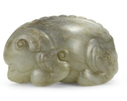 27. a celadon and brown jade mythical beast 17th century
