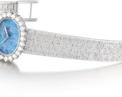 13. audemars piguet | reference bc 8447 z421 a white gold and diamond-set bracelet watch with opal dial, circa 1970
