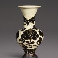 3004. a rare cizhou sgraffiato 'peony' vase northern song dynasty |