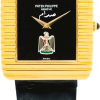 8. patek philippe | reference 3733 a yellow gold wristwatch with onyx dial and state coat of arms, made in 1979