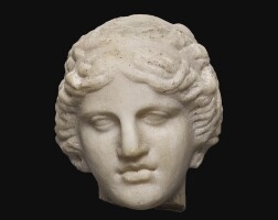 33. a roman marble head of apollo, circa 1st century a.d.   a roman marble head of apollo