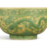 3647. a rare large yellow-ground green-enamelled incised 'dragon' bowl mark and period of jiajing |