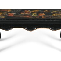 32. a chinoiserie parcel-gilt and black lacquer low table, 20th century  